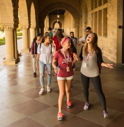 Participants walk through Memorial Quad Arches as they explore campus during a scavenger hunt.