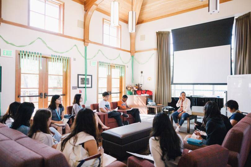 Participants sit together in a large common space in Ng House, a recently built Stanford residence.