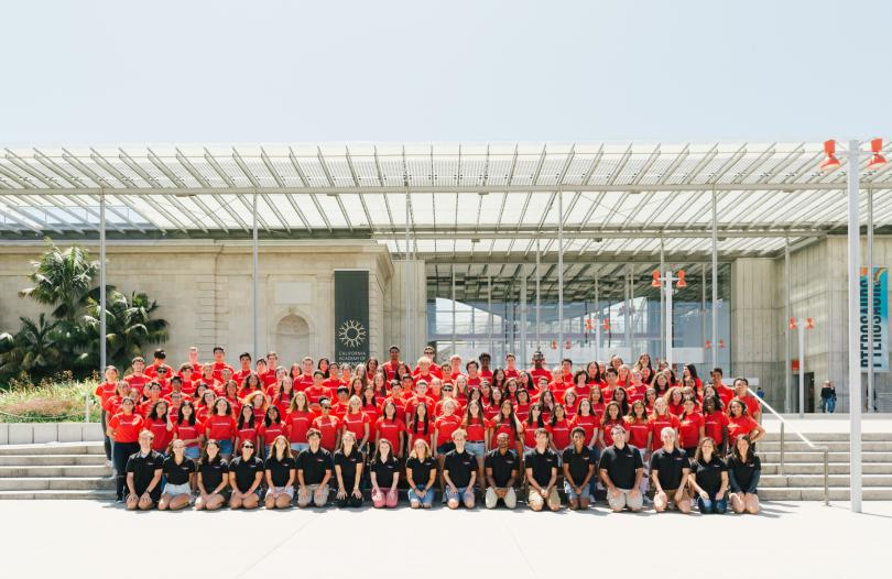 Participants pose in front of the California Academy of Sciences during a field trip.